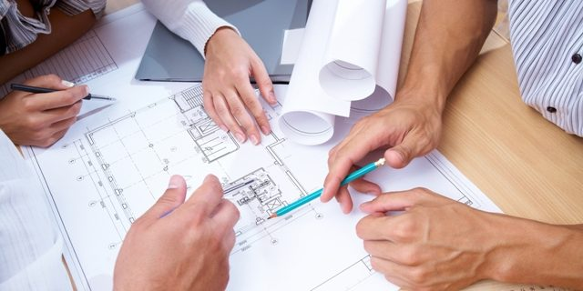 Meeting-looking-at-building-plans